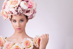 Beautiful  girl with flowers hair