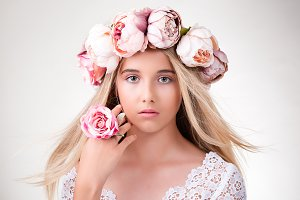 beauty girl with wreath of flowers