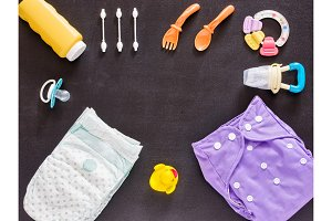 Flat lay of baby set with cloth diaper