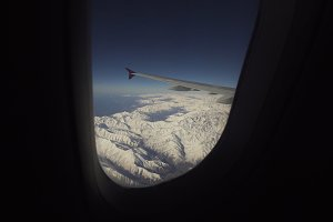 View from airplane window on mountains.