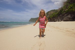 Child runs along the beach.