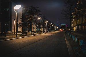 Long empty city street at night