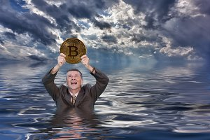 Senior man holds up bitcoin and drowns in ocean