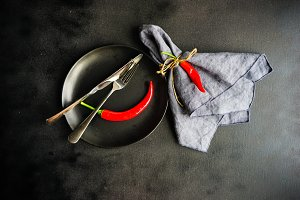 Table setting with red pepper