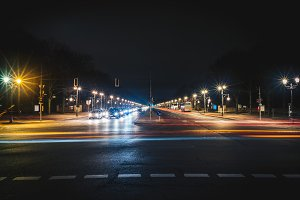 Long wide city road at night
