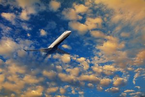 airplane flying the morning sky