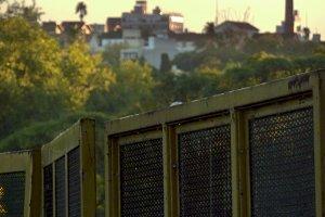 Urban factory behind barriers