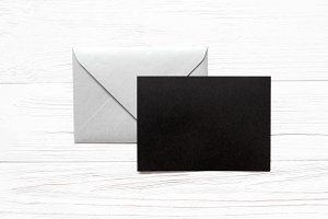 Silver envelope, black paper blank