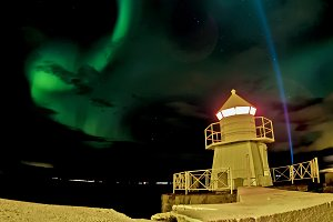 lighthouse under aurora borealis