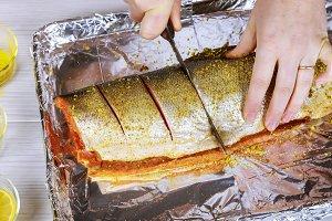 Women's hands are preparing salmon