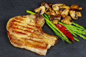 Grilled pork asparagus, mushrooms