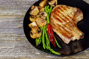 Grilled pork steaks asparagus