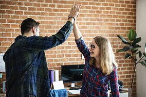 Colleagues give each other high five