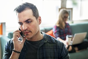 Caucasian man talking on the phone