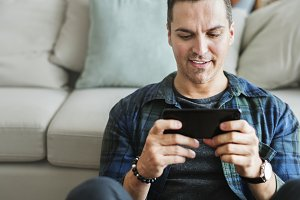 Man playing game in mobile phone