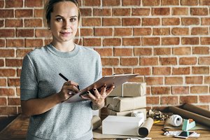 Woman working at parcel service