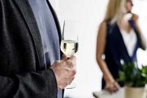Man holding white wine glass