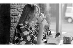 girl drinks tea in a cafe