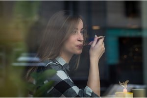 Beautiful girl is drinking tea in a cafe
