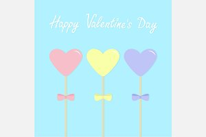 Three hearts with bows on sticks.