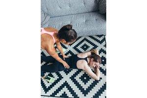 Woman massages her friends back after workout