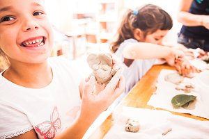 Happy children are engaged with modeling clay