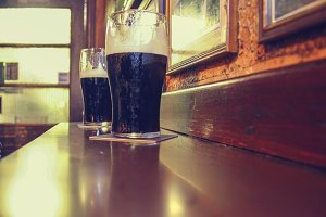 Two dark Irish stout beers