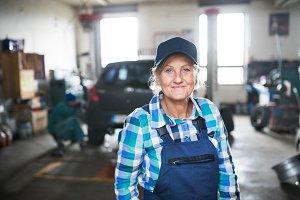 Portrait of a senior female mechanic in a garage.