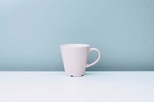 Pink cup on a white table