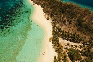 Aerial view beautiful beach on a tropical island Malcapuya. Philippines.