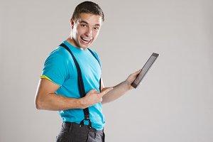 Studio shot od man with tablet.