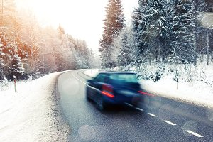 Car driving in winter landscape