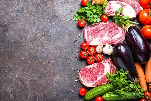 Raw beef meat and vegetables