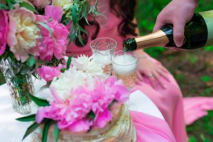 Pouring champagne into a glass on some festive event or wedding