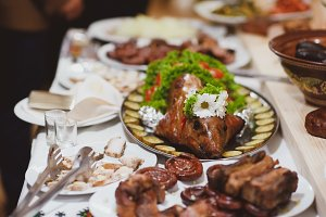 roast pig with vegetables on a banquet table, Ukrainian dish