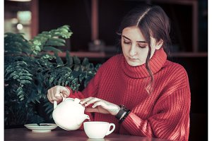 Girl in a cafe drinking tea
