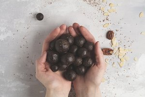 raw vegan sweet balls in hands