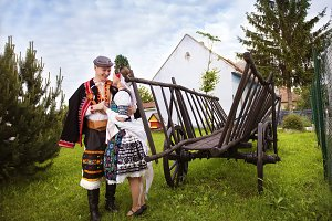Traditional folk couple outdoors.