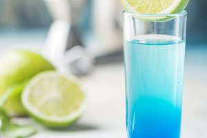 A blue layer alcoholic cocktail