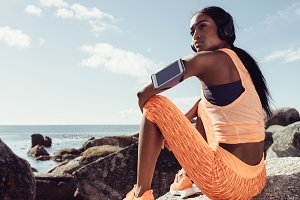 Fit woman relaxing after running