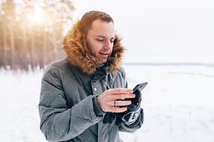 winter man with smartphone