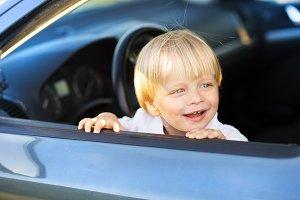 Toddler boy in car.