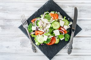A mixed salad with cucumber, tomato