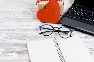 laptop, notebook and gift with heart