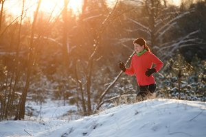 Image of running sports girl in winter forest at morning