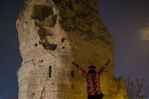 Girl and Natural rock formations - Cappadocia at night, Goreme, Turkey.