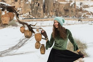Girl and Clay jugs on old tree branches without leaves in Cappadocia,