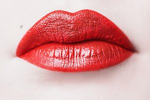 Female lips with red lipstick close-