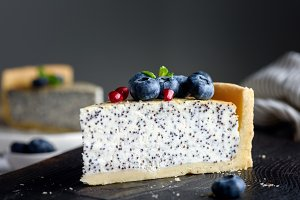 Slice of cheesecake with poppy seeds
