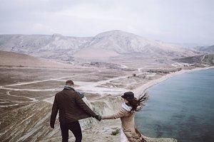 stylish couple, cold sea